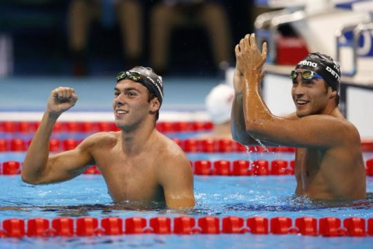 Lrtaeme and third placed Gabriele DETTI of Italy celebrate after competing in the men's 1500m Freestyle Final