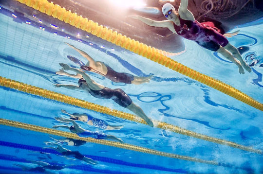 Kelsi Worrell (C) of the United States of America (USA) and Yufei Zhang of China (R) compete in the women's 100m Butterfly Semifinal during the Swimming competition held at the Duna Arena during the 17th FINA World Championships 2017 in Budapest, Hungary, 23 July 2017.